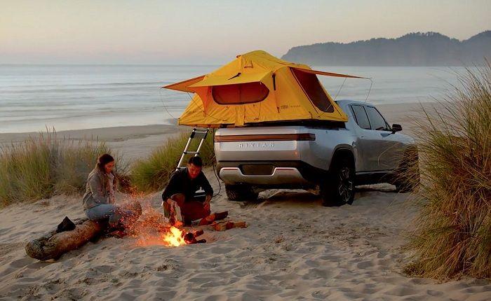Rivian R1T camping at the beach